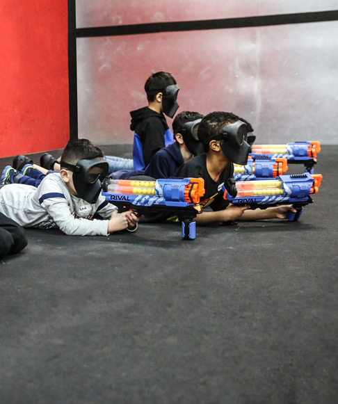 4 kids with nerf guns indoors in London